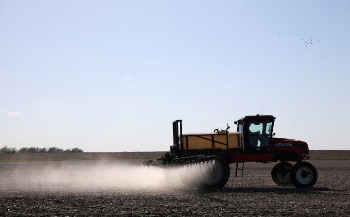 A farmer applies pesticides to a field in Hastings, Iowa, in 2015. The Biden administration said Wednesday it will ban the use of chlorpyrifos, an insecticide.