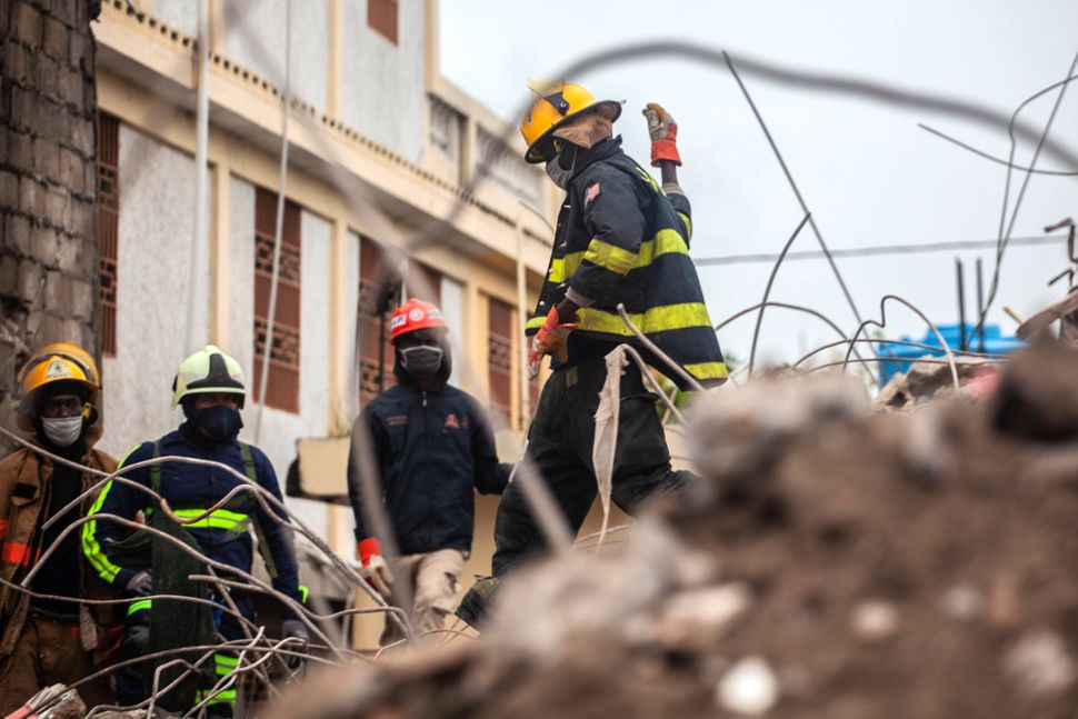 The magnitude 7.2 earthquake destroyed more than 7,000 homes and damaged more than 12,000. Firefighters are still searching f
