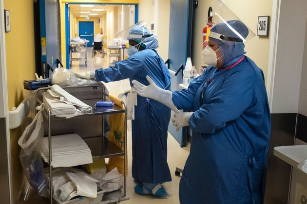 Nurses at the Covid hospital ward of the GVM Maria Pia Hospital in Turin prepare to visit patients infected with Covid-19 on April 4, 2021. (Photo by MARCO BERTORELLO / AFP) (Photo by MARCO BERTORELLO/AFP via Getty Images)