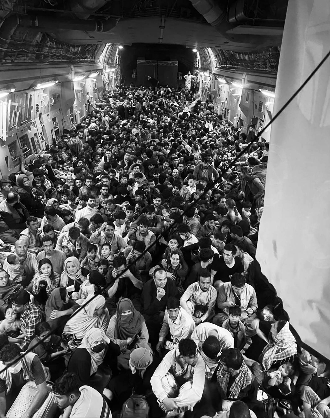 Afghan citizens are packed inside a U.S. Air Force C-17 Globemaster III as they're transported from Hamid Karzai International Airport in Afghanistan last Sunday.