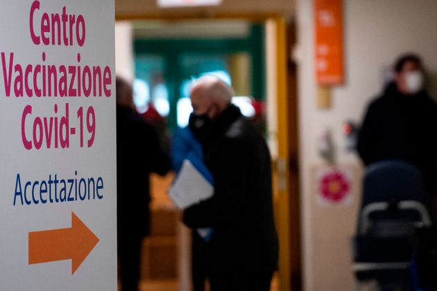 A board is pictured at the admission of the Tor Vergata hospital in Rome on February 8, 2021, during vaccinations for people over 80. - Italy is one of the countries worst affected by the coronavirus pandemic, with over 2.6 million infections and more than 91,000 dead. (Photo by Tiziana FABI / AFP) (Photo by TIZIANA FABI/AFP via Getty Images)