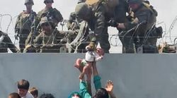 Afghan Parents Pass Crying Children Over Kabul Walls In Desperate Attempt To