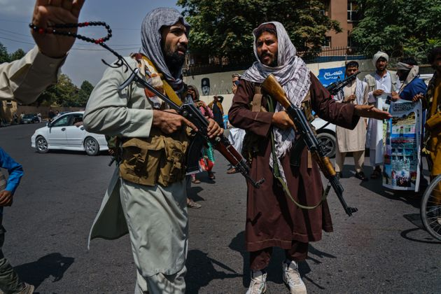 Taliban fighters mobilize to control a