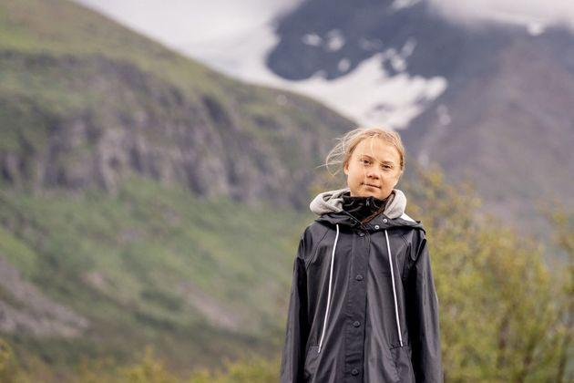Swedish climate activist Greta Thunberg poses for a