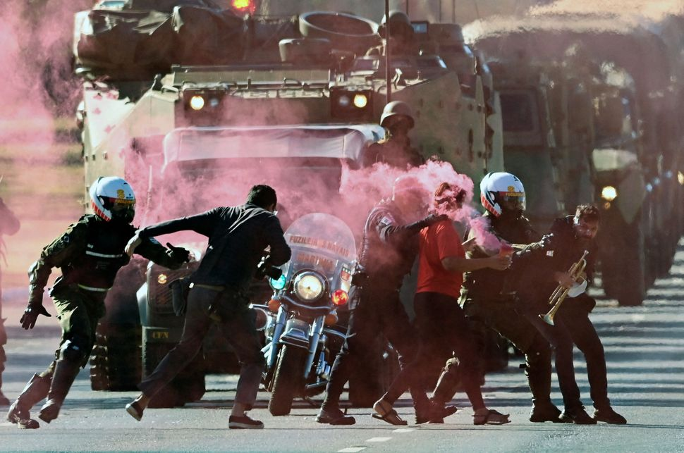 Brazilian military police arrest protesters who tried to block an armed forces parade through Brasília, the country's