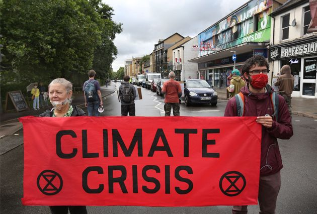 Protesters hold a banner saying climate crisis during the demonstration in