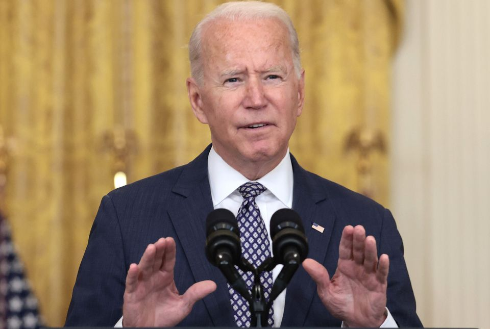 President Joe Biden addresses reporters at the White House on Friday. He tried to dispel the idea that...