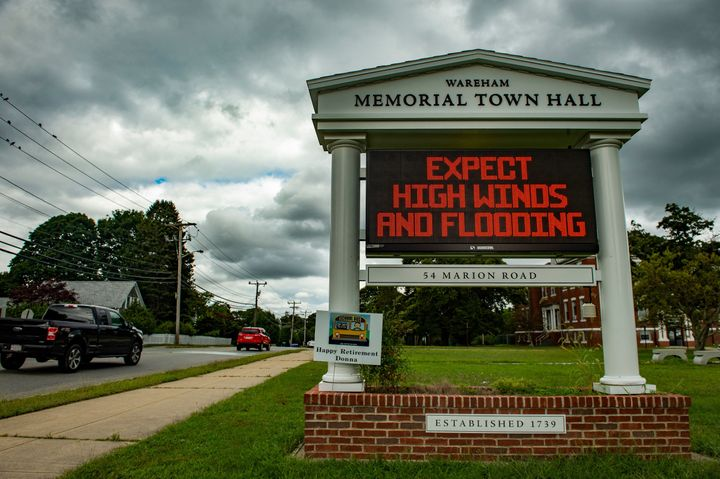A sign outside the local Town Hall warns people to prepare for high winds and flooding as the impeding Tropical storm Henri expected to make landfall as a Hurricane on Sunday, approaches in Wareham, Massachusetts on August 20, 2021.