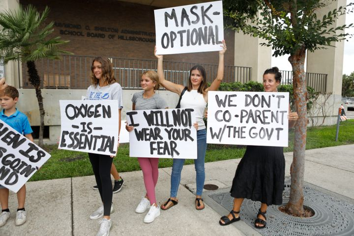 Families protest any potential mask mandates before the Hillsborough County Schools Board meeting held at the district office