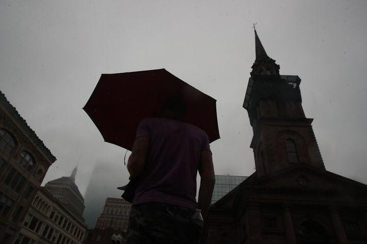 A man walks on Boylston Street in Boston, Massachussetts on Thursday, August 19, 2021.