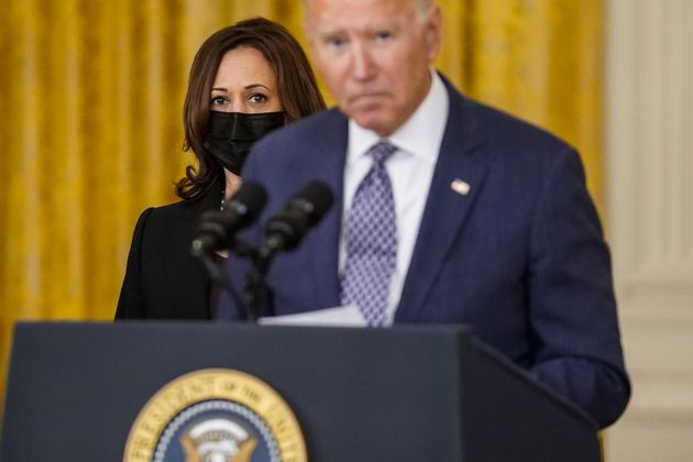 WASHINGTON, DC - AUGUST 20: Vice President Kamala Harris looks on as President Joe Biden, flanked by Secretary of Defense Lloyd Austin, Secretary of State Antony Blinken and White House National Security Advisor Jake Sullivan, takes a question from a reporter after delivering remarks on the evacuation of American citizens and their families, SIV applicants and their families, and vulnerable Afghans from Afghanistan, in the East Room of the White House complex on Friday, Aug. 20, 2021 in Washington, DC. (Kent Nishimura / Los Angeles Times via Getty Images)