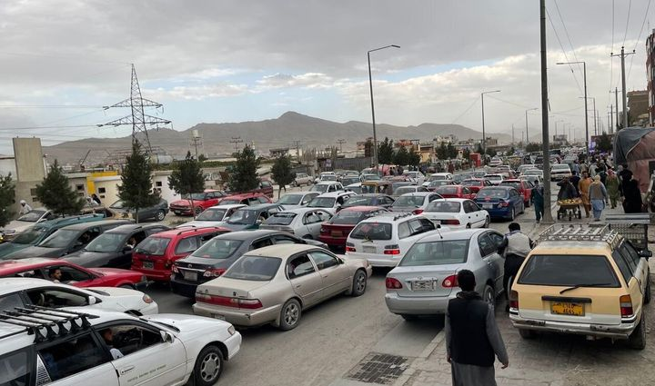 Afghans continue to wait around the Hamid Karzai International Airport as they try to leave the Afghan capital of Kabul on Saturday.