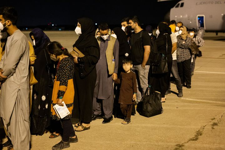 Passengers disembark a plane in Spain after evacuating from Kabul on Aug. 19. The plane, sent by the government of Spain, repatriated a first group of 55 Spaniards and Afghan collaborators.