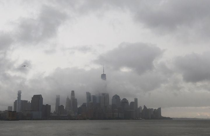 The remnants of storm system Henri pass through lower Manhattan in New York City on Aug. 22 2021 as seen from Hoboken, New Je