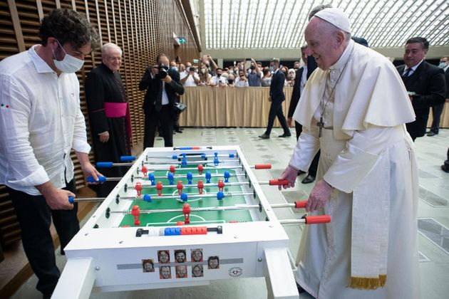 This handout photo provided by the Vatican Media shows Pope Francis playing soccer table during the weekly general audience in Paul VI Hall, Vatican City, 18 August 2021. ANSA/ VATICAN MEDIA