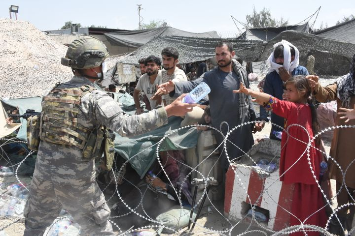 Soldiers of the Turkish Task Force in Afghanistan are on duty in and around Hamid Karzai International Airport to help people who are waiting for evacuation, in Kabul, Afghanistan on Aug. 23, 2021.