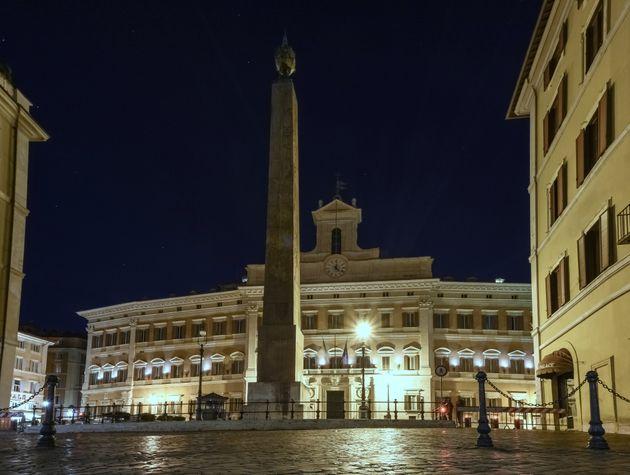 Montecitorio (Parliament building) illuminated at night in Rome, Lazio, Italy, a UNESCO heritage