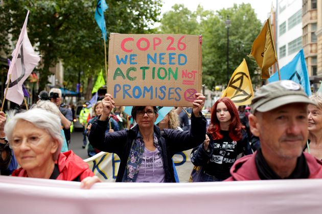 Members of climate change activist movement Extinction Rebellion march along Charing Cross Road on August...