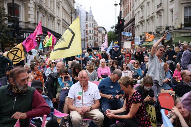 Extinction Rebellion protesters take part in a protest in the Covent Garden area on August 23,