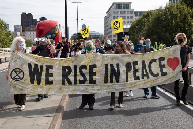 Extinction Rebellion Shell Out protest 'We rise in peace' banner on 8th September 2020 in London, United