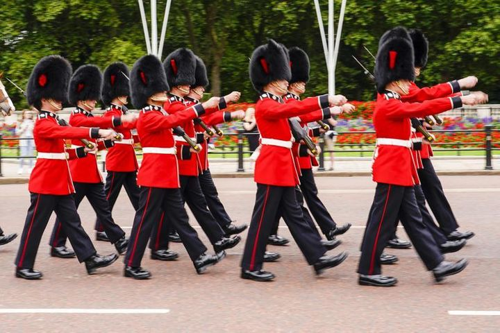 Members of the public watch the Changing of the Guard ceremony at Buckingham Palace, London, Monday August 23, 2021, which is taking place for the first time since the start of the coronavirus pandemic.