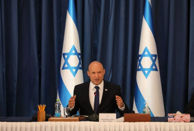 Israeli Prime Minister Naftali Bennett chairs the weekly cabinet meeting in Jerusalem on August 22, 2021. (Photo by GIL COHEN-MAGEN / POOL / AFP) (Photo by GIL COHEN-MAGEN/POOL/AFP via Getty Images)