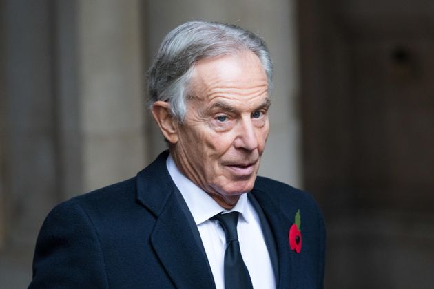 epa08807273 Britain's former Prime Minister Tony Blair walks through Downing Street to attend the National...