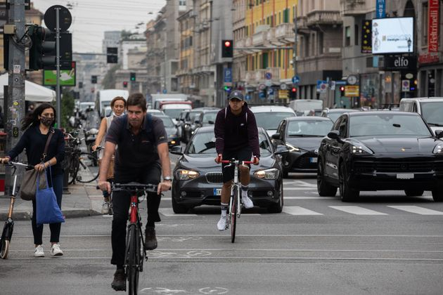 MILAN, ITALY - SEPTEMBER 23: People ride bicycles on a pop-up bike lane on Corso Buenos Aires on September 23, 2020 in Milan, Italy. Since the end of lockdown Milan authorities have added a further 35 kilometers of pop-up bike lanes and cycle paths and encouraged cycling and riding e-scooters as a safer form of transport away from jam-packed buses or subway trains, in order to promote social distancing in response to COVID-19. (Photo by Emanuele Cremaschi/Getty Images)
