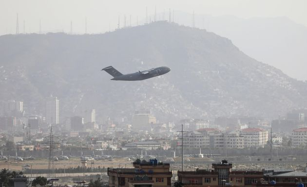 A military plane takes off from Hamid Karzai International Airport in Kabul, Afghanistan, 23 August 2021. An Afghan policeman was killed on 23 August, in a gun battle between security forces and unknown attackers at the North Gate of the Kabul airport, the German military said, amid ongoing chaos at the airport as thousands try to flee Taliban rule. EPA/STRINGER