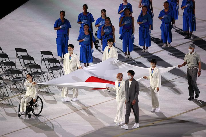 The Japanese flag is carried into the stadium during the opening ceremony of the Tokyo 2020 Paralympic Games at the Olympic Stadium on Aug. 24, 2021 in Tokyo.