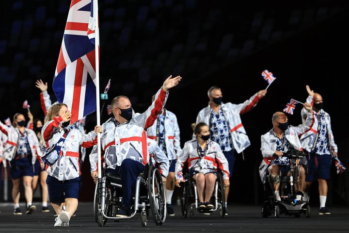 Flag bearers Eleanor Simmonds and John Stubbs of Team Great Britain lead their delegation in the parade of athletes during the opening ceremony of the Tokyo 2020 Paralympic Games.
