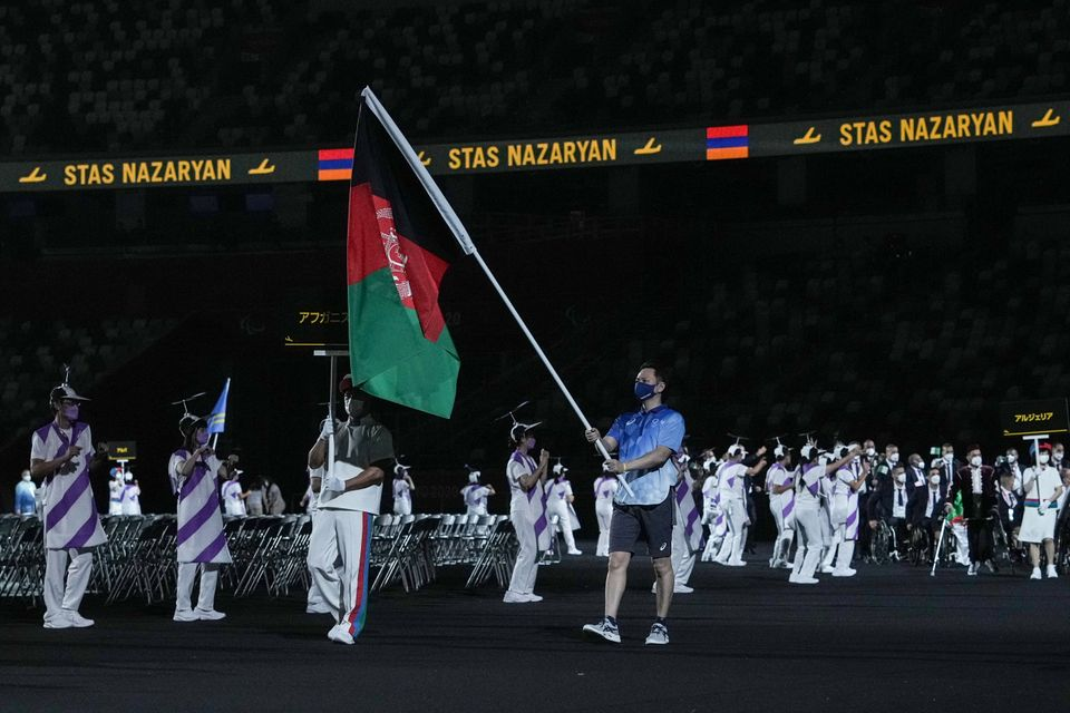 The flag of Afghanistan is carried out at the opening ceremony for the Tokyo 2020 Paralympic