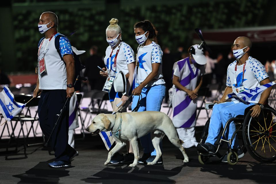 Athletes from Team Israel enter the stadium during the parade of athletes during the opening ceremony...