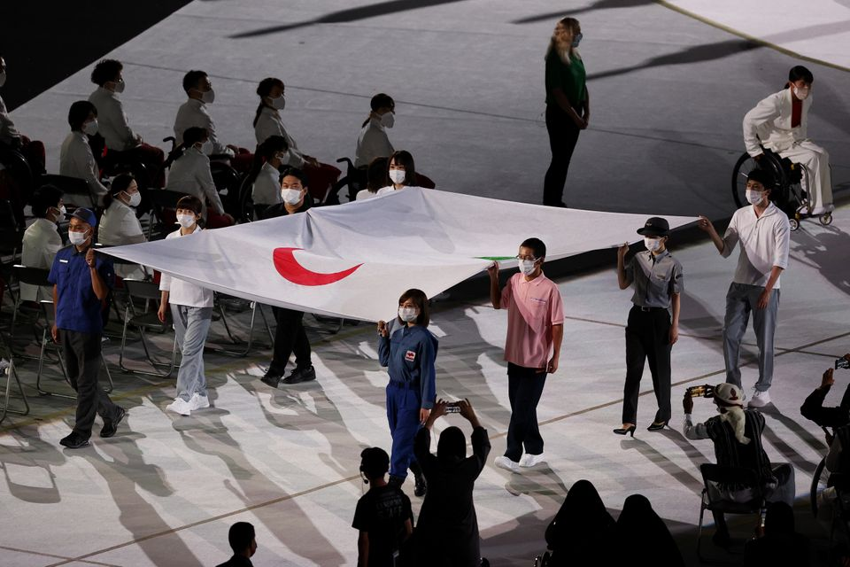 The Paralympic flag is brought in during the opening ceremony of the Tokyo 2020 Paralympic Games at the...