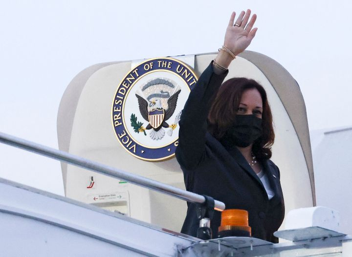 Vice President Kamala Harris waves before departing Singapore on Aug. 24.
