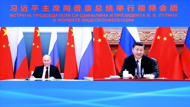 Chinese President Xi Jinping holds talks with Russian President Vladimir Putin via video link in Beijing,...