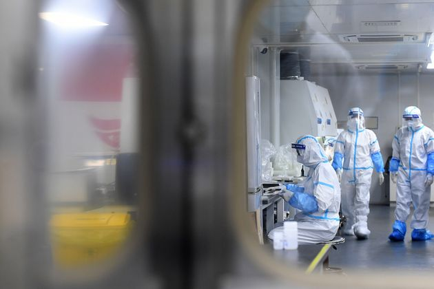 WUHAN, CHINA - AUGUST 05 2021: People in PPE work in the Huo-Yan (Fire Eye) Laboratory designed for high-capacity 2019-nCoV (SARS-CoV-2) detection in Wuhan in central China's Hubei province Thursday, Aug. 05, 2021. (Photo credit should read Feature China/Barcroft Media via Getty Images)