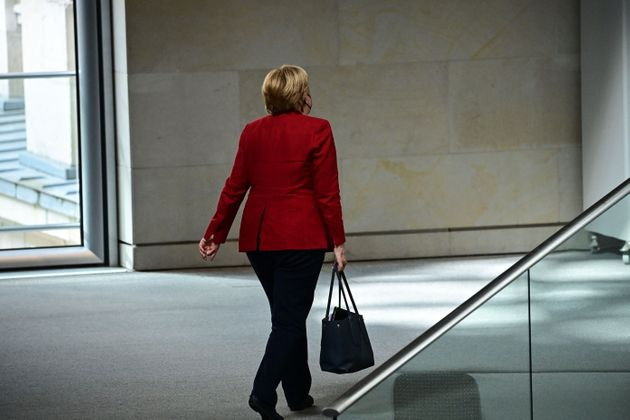 German Chancellor Angela Merkel leaves the plenary session in the German lower house of parliament Bundestag in Berlin on August 25, 2021. (Photo by Tobias SCHWARZ / AFP) (Photo by TOBIAS SCHWARZ/AFP via Getty Images)