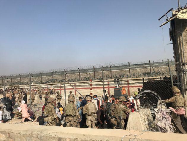 Afghans enter Kabul airport in Kabul, Afghanistan, Aug. 22, 2021. Seven Afghan civilians were killed...