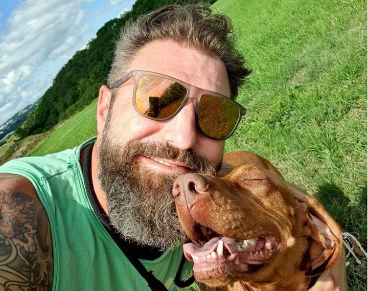 Rob Osman and his dog, Mali.