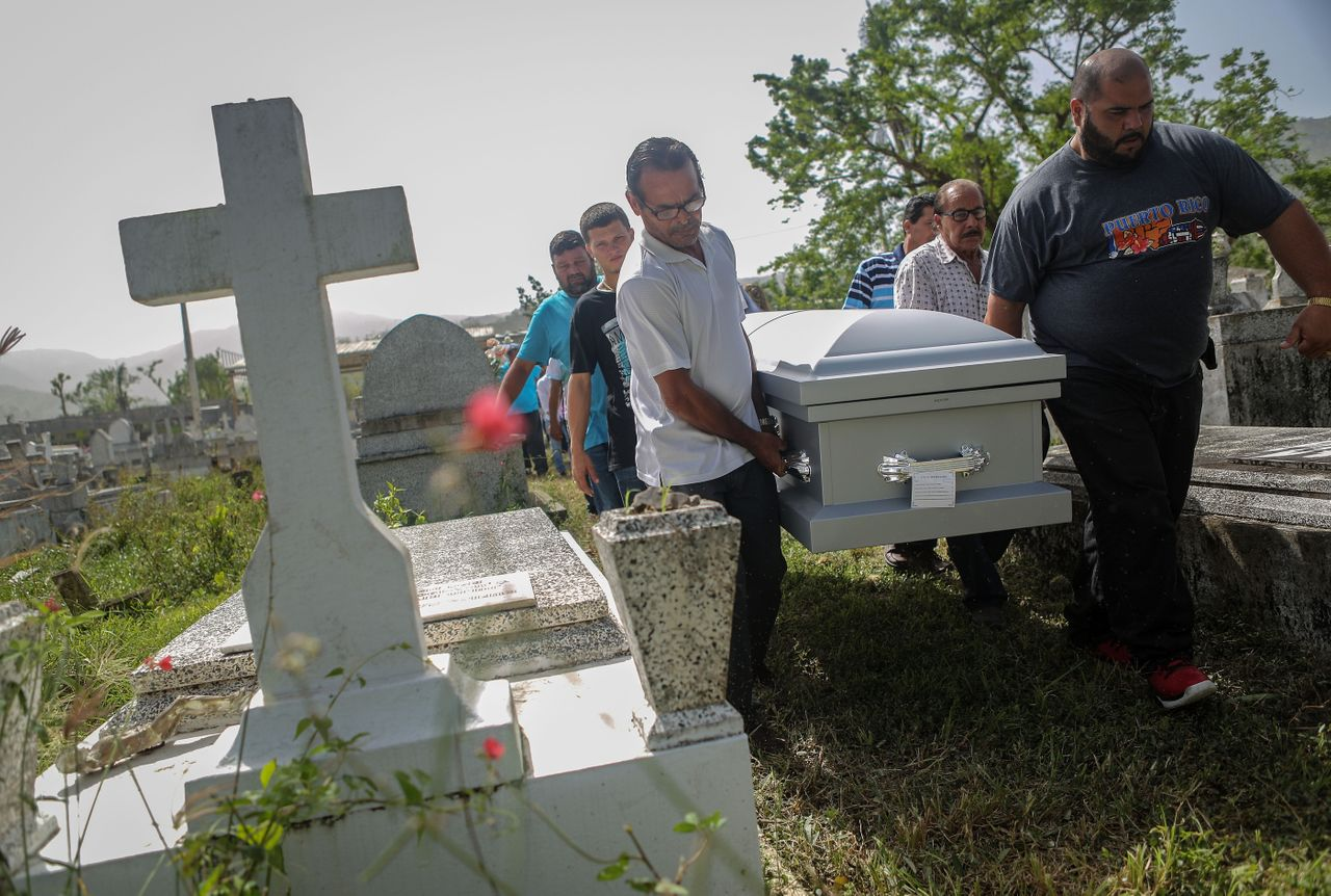 Mourners carry the casket of Wilfredo Torres Rivera, 58, who died Oct. 13, 2017, after jumping off a bridge three weeks after Hurricane Maria, in Utuado, Puerto Rico.