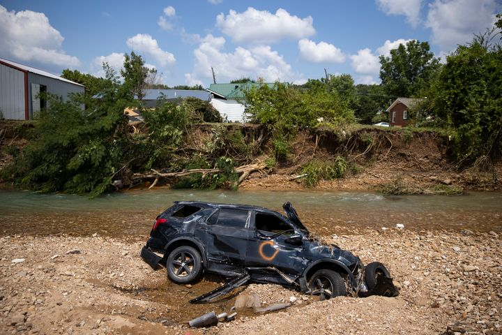 A vehicle destroyed by flooding sits in Trace Creek in Waverly, Tennessee. Heavy rains on Sunday caused flash flooding in the area, killing at least 22 people.