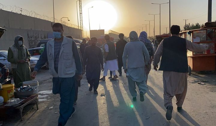 People who want to flee the country continue to wait around Hamid Karzai International Airport in Kabul, Afghanistan on Aug.