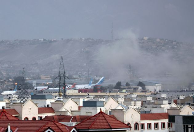 Smoke rises from explosion outside the airport in Kabul,