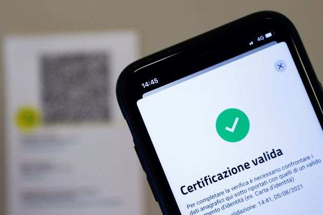 The VerificaC19 app, a smartphone app designed to scan and check the Green Pass (health pass) which has become mandatory to access an array of services and leisure activities, is seen on a mobile phone, amid the coronavirus disease (COVID-19) pandemic, in this illustration picture taken in Rome, Italy, August 5, 2021. Picture taken August 5, 2021. REUTERS/Guglielmo Mangiapane/Illustration
