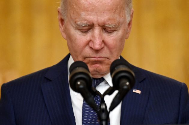 TOPSHOT - US President Joe Biden pauses as he delivers remarks on the terror attack at Hamid Karzai International Airport, and the US service members and Afghan victims killed and wounded, in the East Room of the White House, Washington, DC on August 26, 2021. - The 12 US military troops killed in the bombing attack on Kabul airport Thursday amounted to the worst single-day loss for the Pentagon in Afghanistan since 2011. (Photo by Jim WATSON / AFP) (Photo by JIM WATSON/AFP via Getty Images)