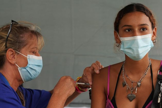 A festival-goer gets an injection at a walk-in Covid-19 vaccination clinic at the Reading Festival on...