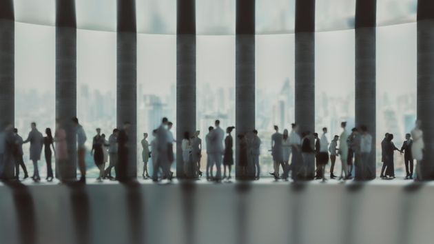 Defocused business people in the office lobby. 3D generated image.