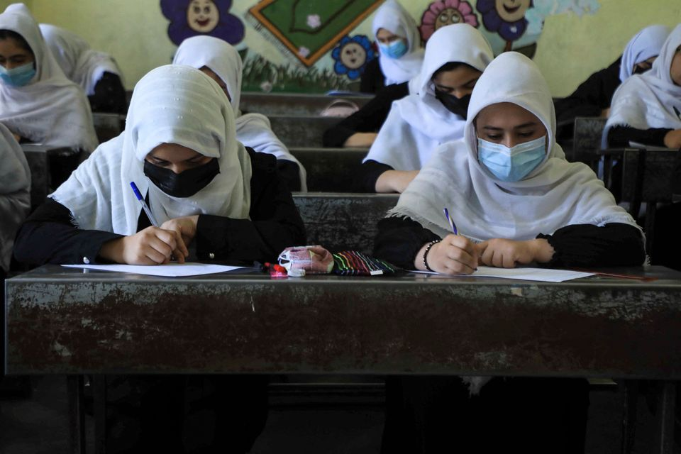 TOPSHOT - Schoolgirls attend class in Herat on August 17, 2021, following the Taliban stunning takeover...