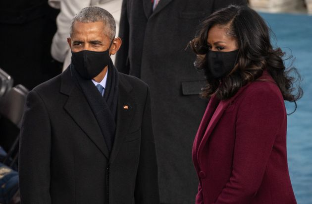 WASHINGTON, DC - JANUARY 20: (L-R) Former US President Barack Obama and Former US First Lady Michelle Obama arrive to the 59th Presidential Inauguration at the U.S. Capitol on January 20, 2021 in Washington, DC. During today's inauguration ceremony Joe Biden becomes the 46th president of the United States. (Photo by Saul Loeb - Pool/Getty Images)